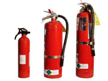three fire extinguishers--small, medium, large